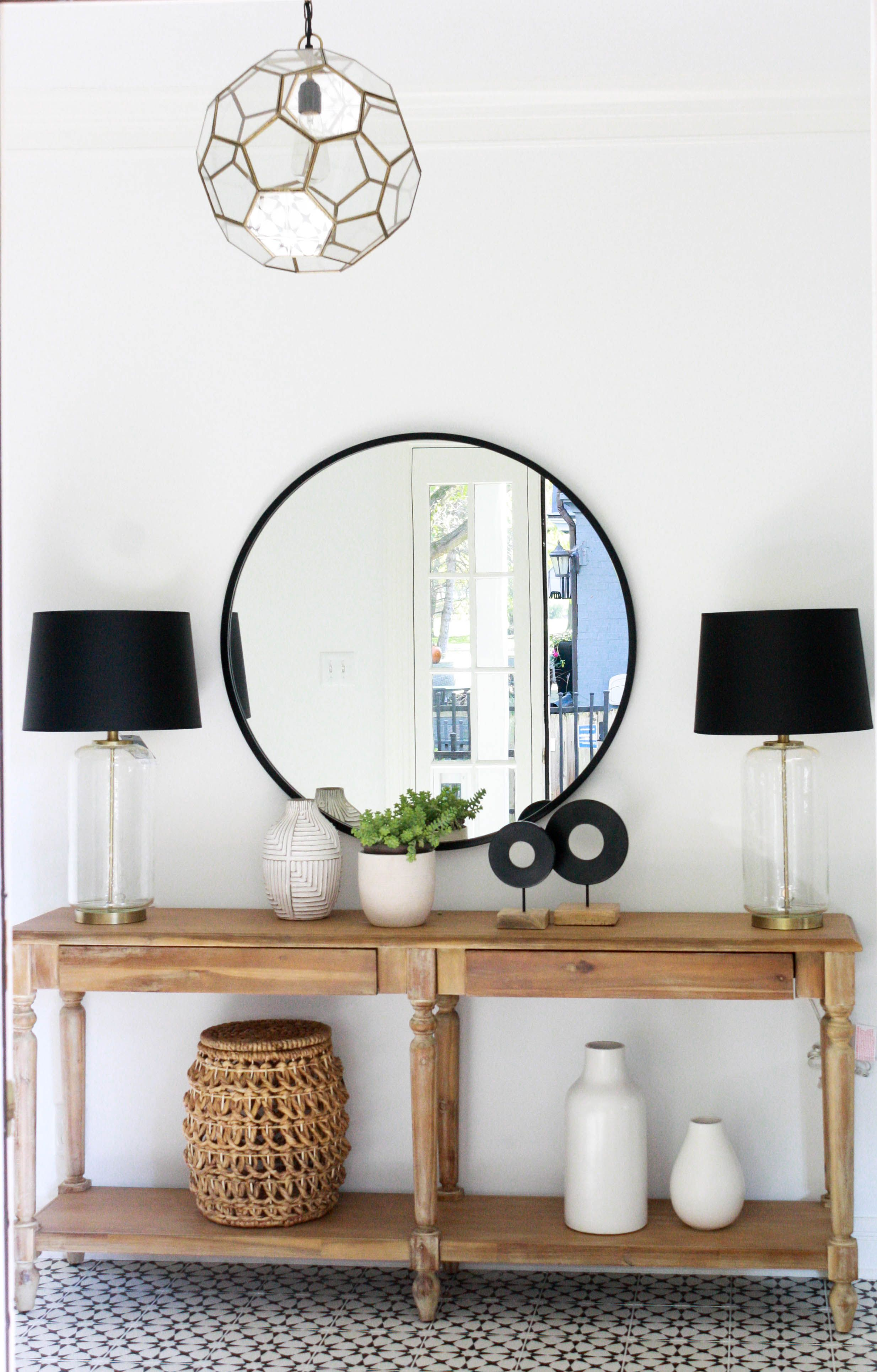 Large Round Mirror Over The Wood Console Table Mosaic Floor Tile Matching Lamps On The Console Table House Seven Desi Foyer Decorating Mirror Decor Decor