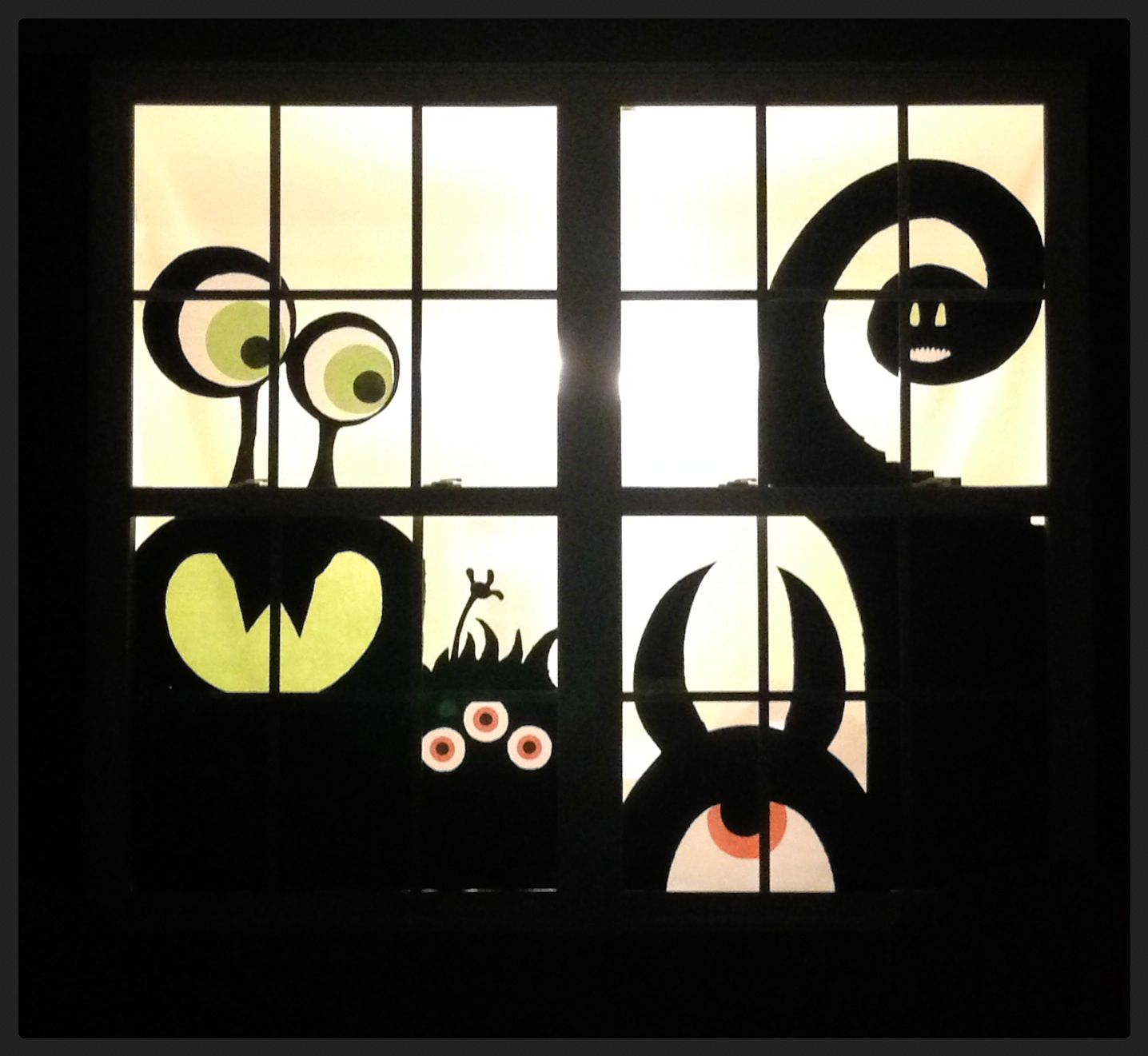 Halloween window decor made from moving boxes and black for Halloween window designs