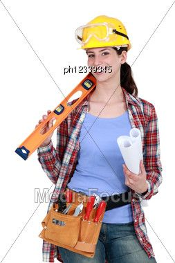 Female Construction Worker Holding Tools And A Rolled-up Plan Stock Photo