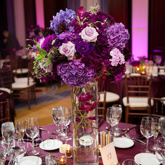 Purple Floral Centerpieces Would Add Blue And Green And White