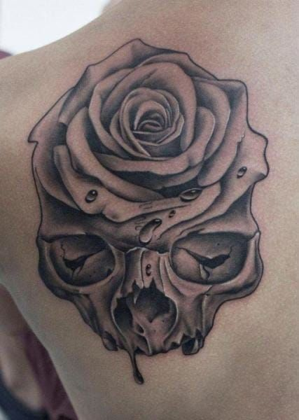 Rose Tattoos Meaning Placement Ideas Our Guide Skull Rose Tattoos Black And Grey Rose Tattoo Rose Tattoos