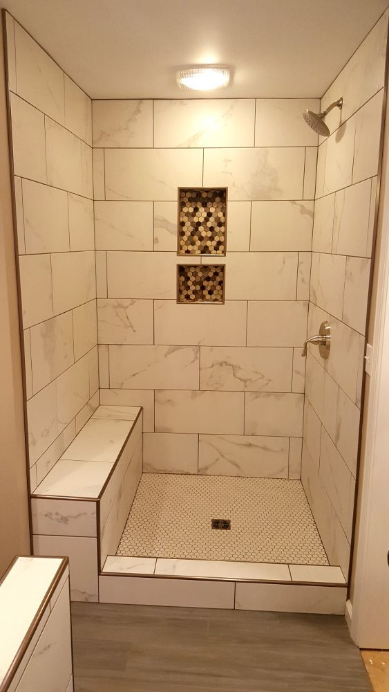 Grouted 12 X 24 Tile With Marble Look Schluter Edging On All Corners Bathroom Remodel Shower Bathrooms Remodel Guest Bathrooms