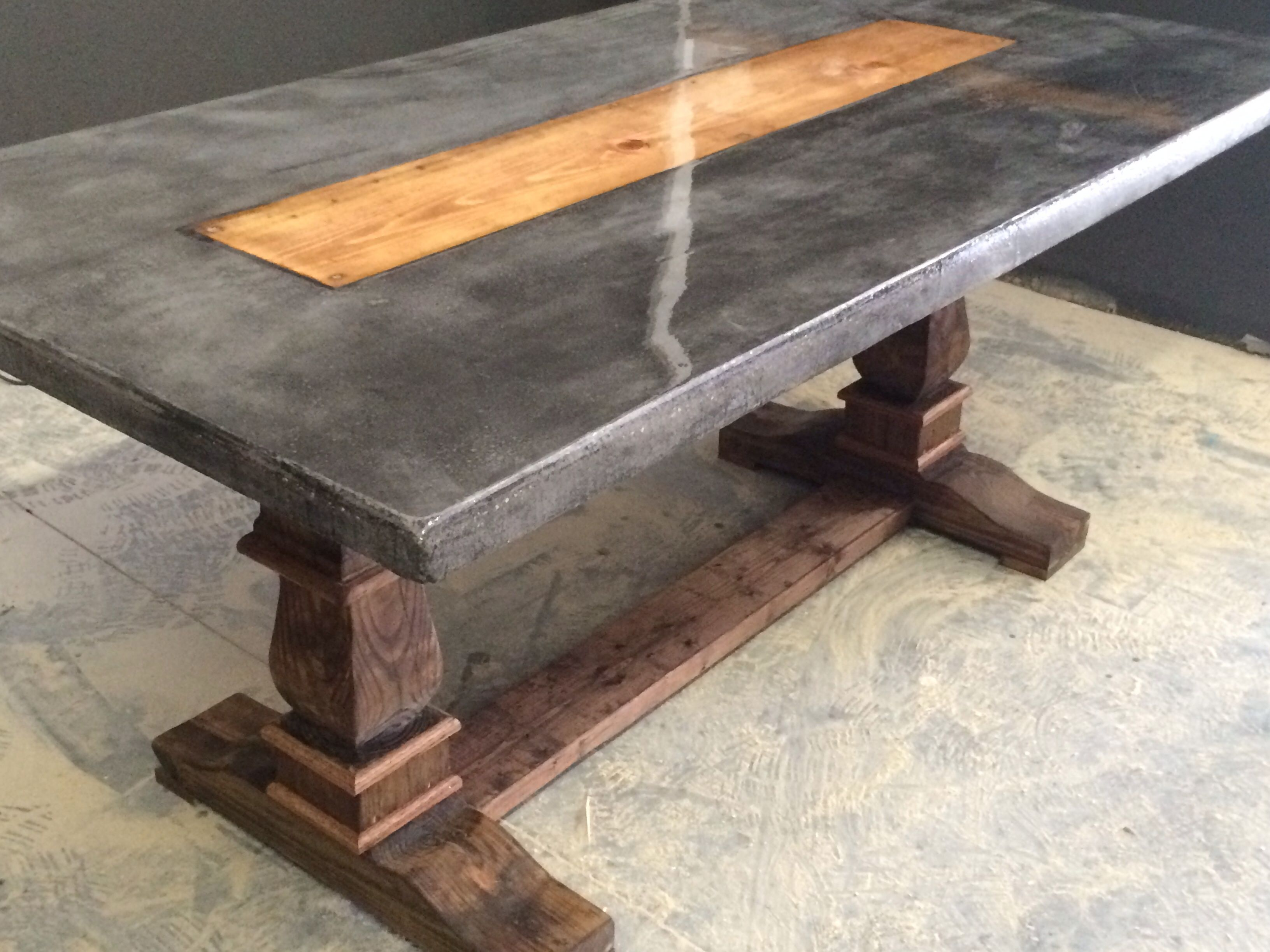 Regular concrete with dark dye added and a wooden inlay with resin top and hand carved pedestal Concrete and wood furniture