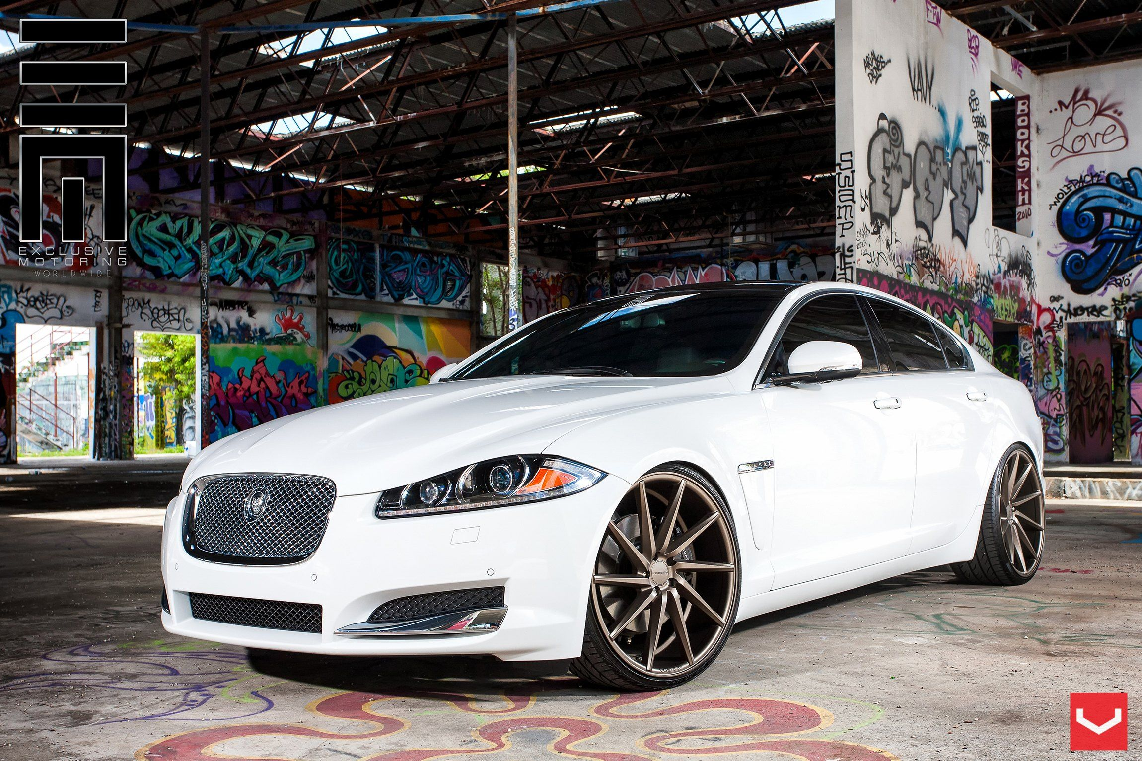 Diamond White Jaguar Xf Put On Classy Bronze Custom Wheels Jaguar Xf Jaguar Custom Wheels