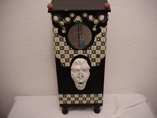 old electric meter cover, mixed medium, sea shells, sea glass, rocks and plaster mask