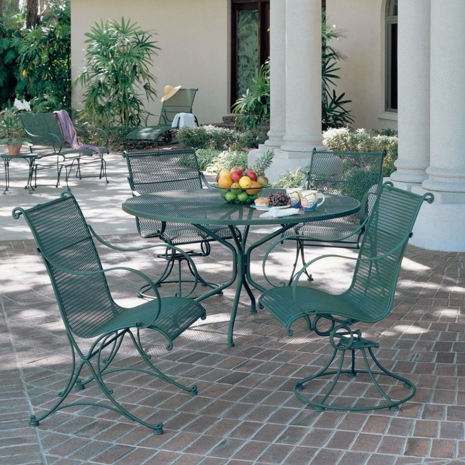 Creative Green Wrought Iron Patio Furniture Of Large Round Garden Table  With Decorative Tea Cups And
