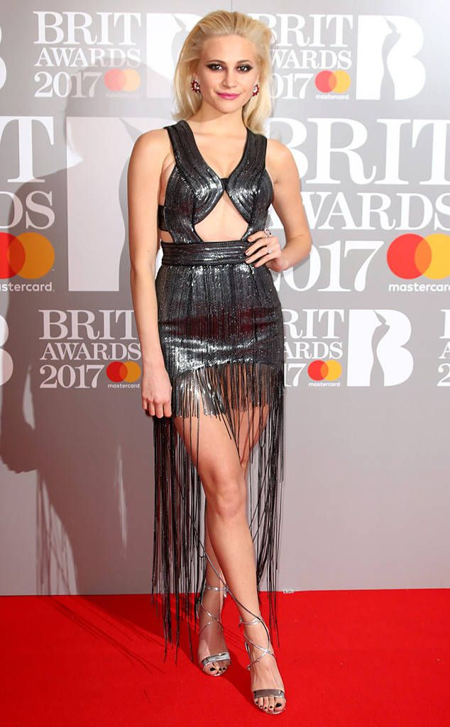 8fbf293e5e0d The English singer and actress looked like a total rockstar in metallic  fringe on the red carpet.