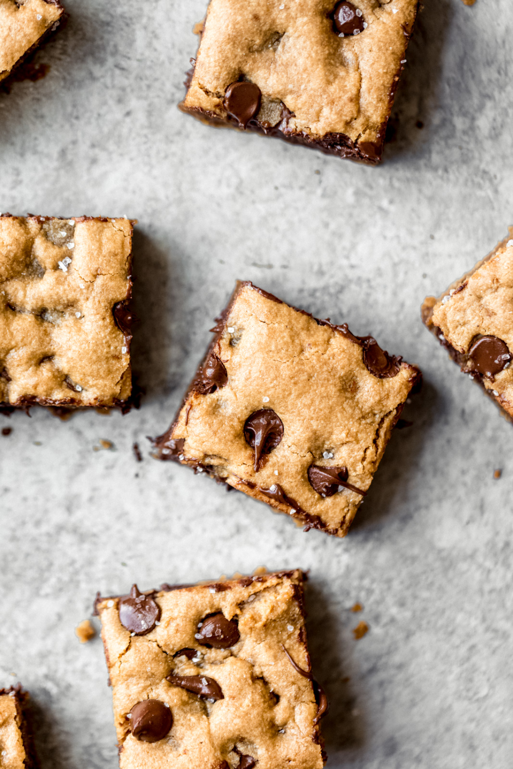 Paleo chocolate chip tahini blondies that are gooey with nutty, earthy notes and chocolate puddles in every bite. These will be your go-to dessert for parties, or whenever you need something sweet. #blondies #tahini #healthydessert #glutenfreedessert #glutenfreerecipe #grainfreedessert #grainfreerecipe #dairyfreerecipe #paleodessert #paleorecipe