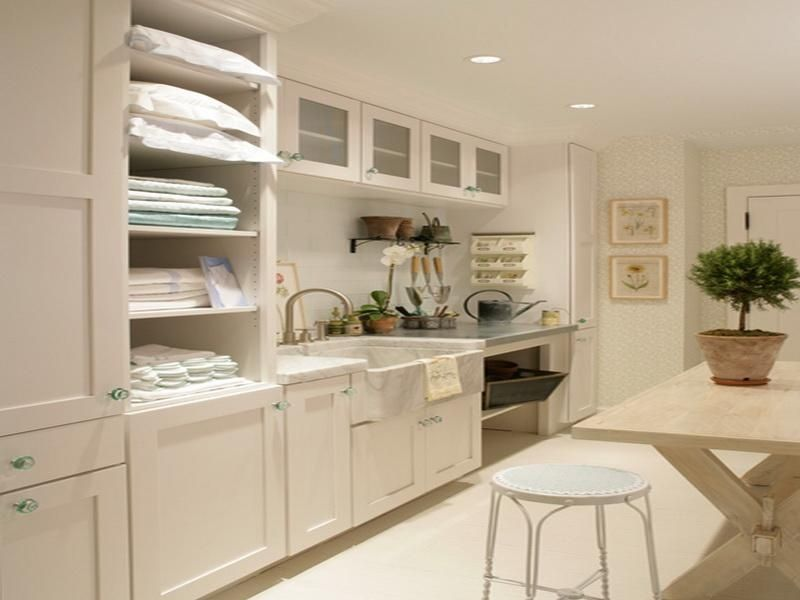 Cottage Laundry Room With High Ceiling, Interior Wallpaper, Farmhouse Sink,  Depression Green Glass Cabinet Knob, Carpet
