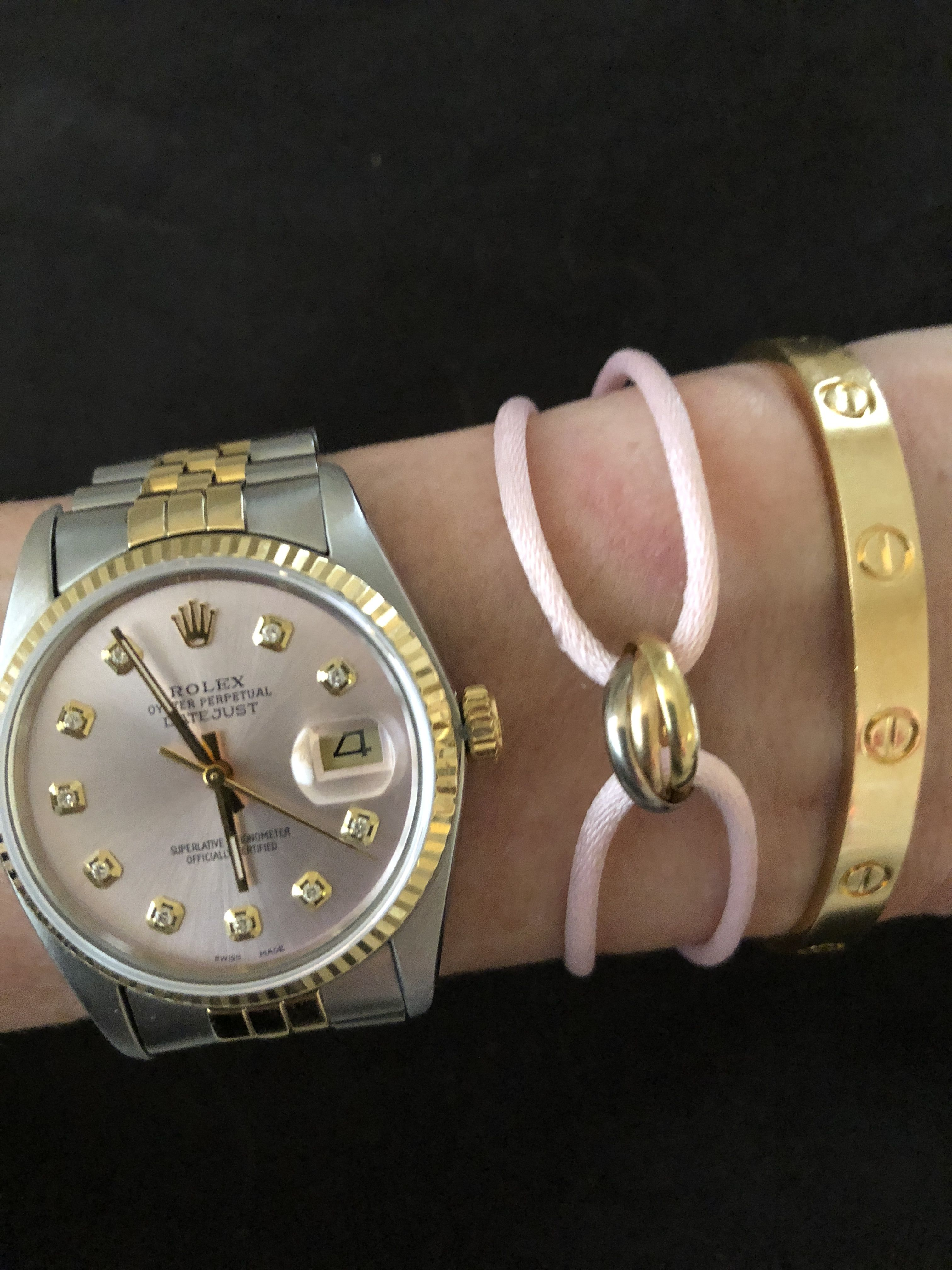 20982dc3189a4 Cartier Love bracelet, Cartier Trinity bracelet on pink cord, Rolex ...