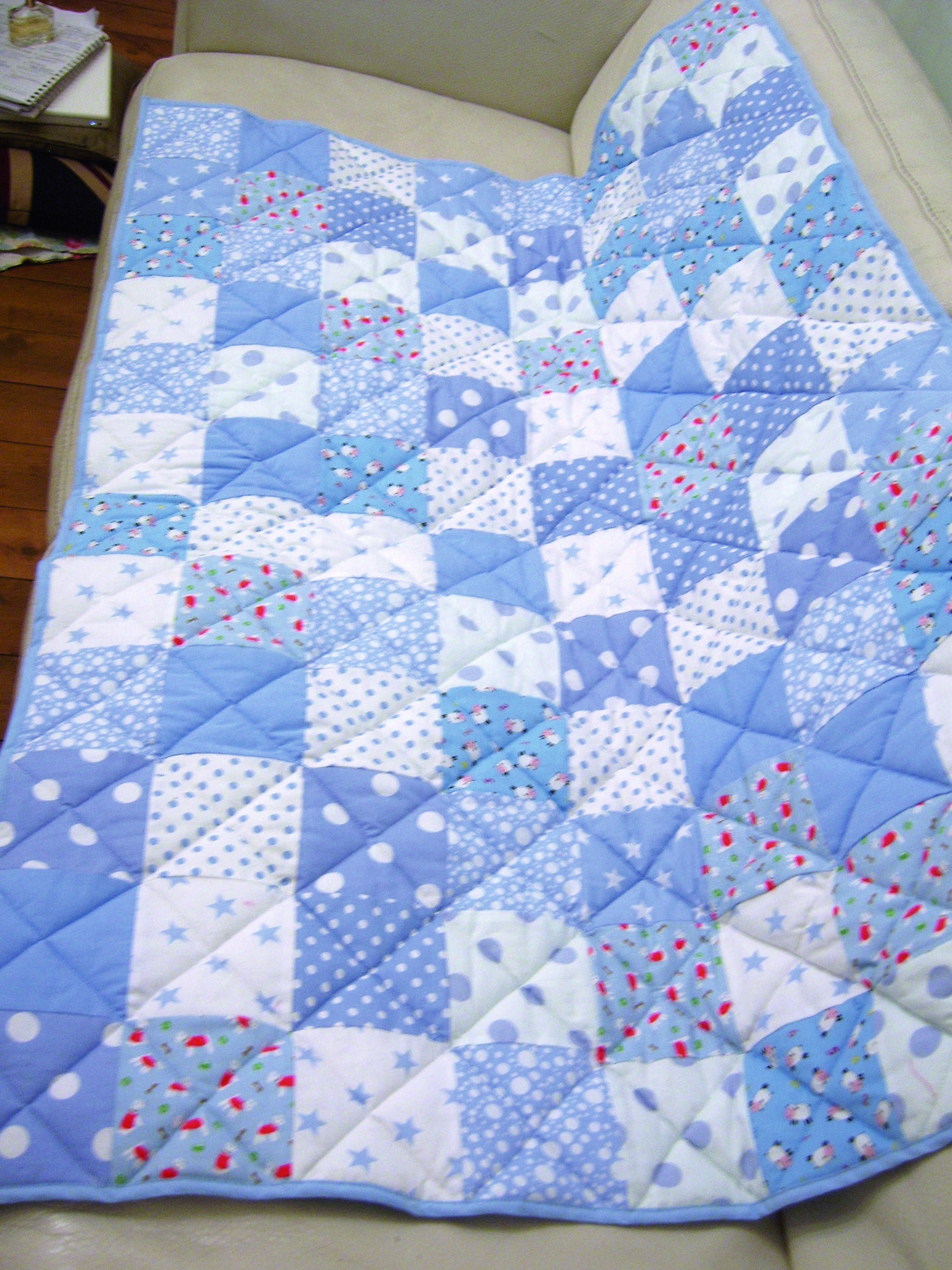 Patchwork quilt - detail (quilting is machine-stitched diagonal lines)