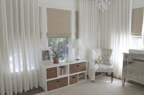 LOVE LOVE LOVE the roman shades with the long sleek white curtains and mirrored dresser