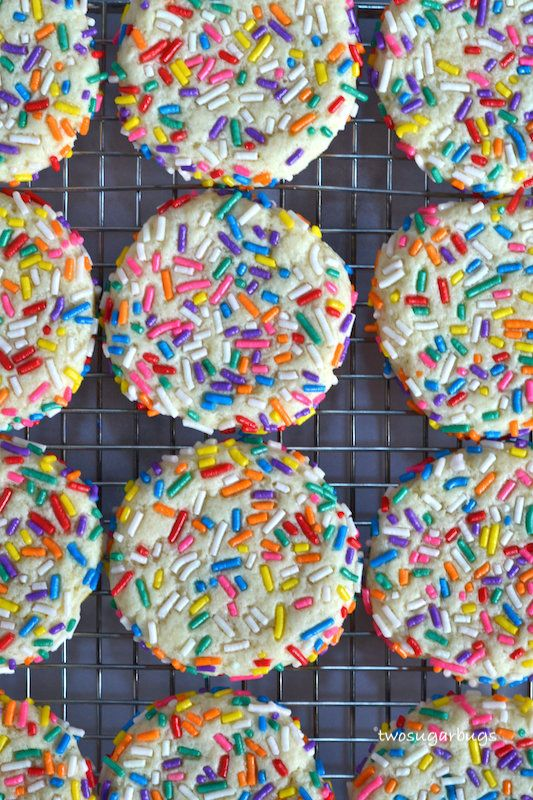 Sprinkle Cookies ~ This EASY cookie recipe creates the best soft, chewy, sprinkle covered sugar cookies!! No need to bring your butter and cream cheese to room temperature and NO CHILL time. Better than any bakery cookie and ready in about 30 minutes! ~ #sprinklecookies #sugarcookies #nochillcookierecipe #easycookierecipe #softsugarcookies