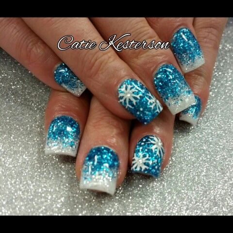 Blue and white glitter winter nails with snowflakes