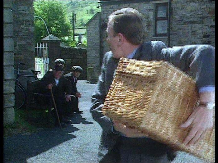 Hampered (1990) Village Hall, Muker, Swaledale, North Yorkshire - : James gets a hamper from Mrs Pumphrey at the village vegetable show.