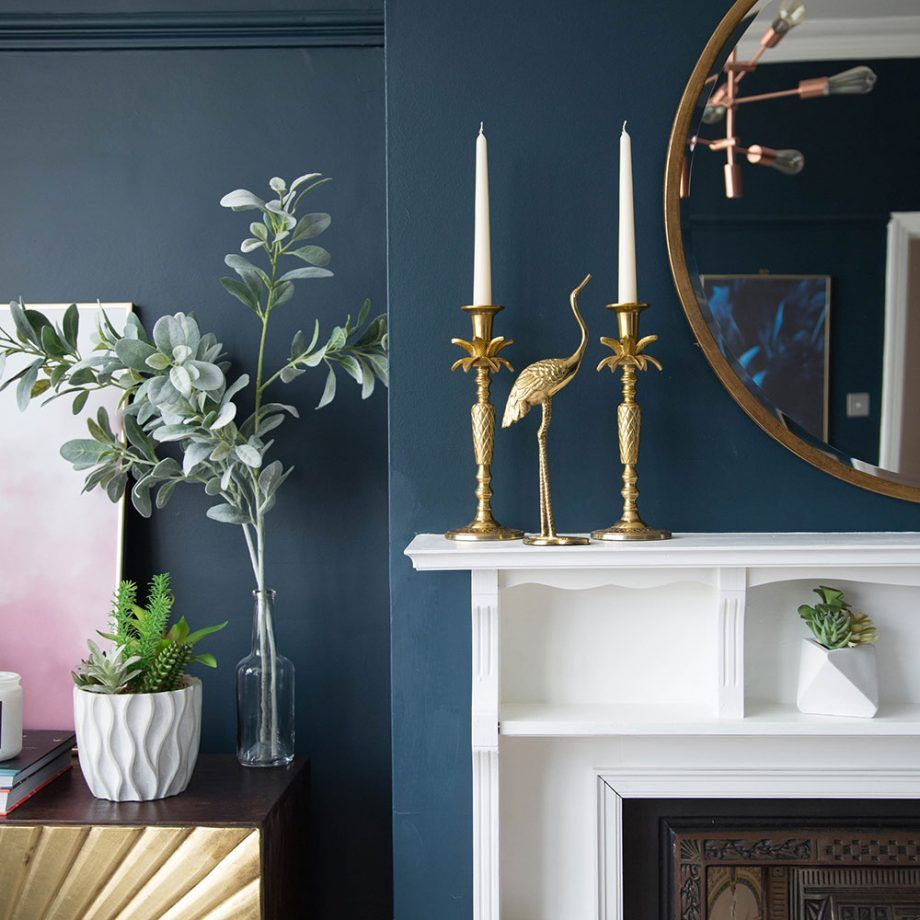 Living room makeover with dark blue walls, pink sofa and ...