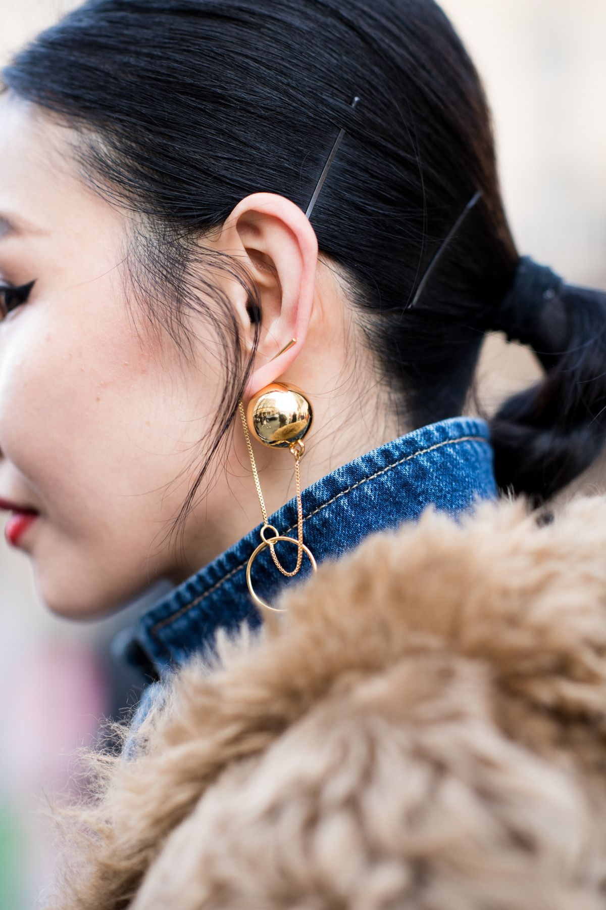 Statement earrings make an outfit, shop now at Farfetch