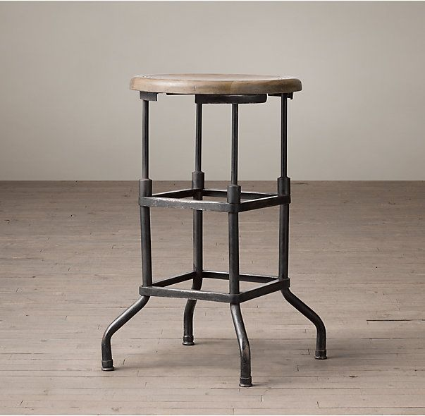 RH's 1920s American Factory Stool:Our stool's square iron base and incised wood top were inspired by an industrial seat from the 1920s – a predecessor to the famous Rite-Hite stool that became a factory fixture decades later. While the original was height-adjustable via telescoping legs, our reproduction is fixed at bar height.