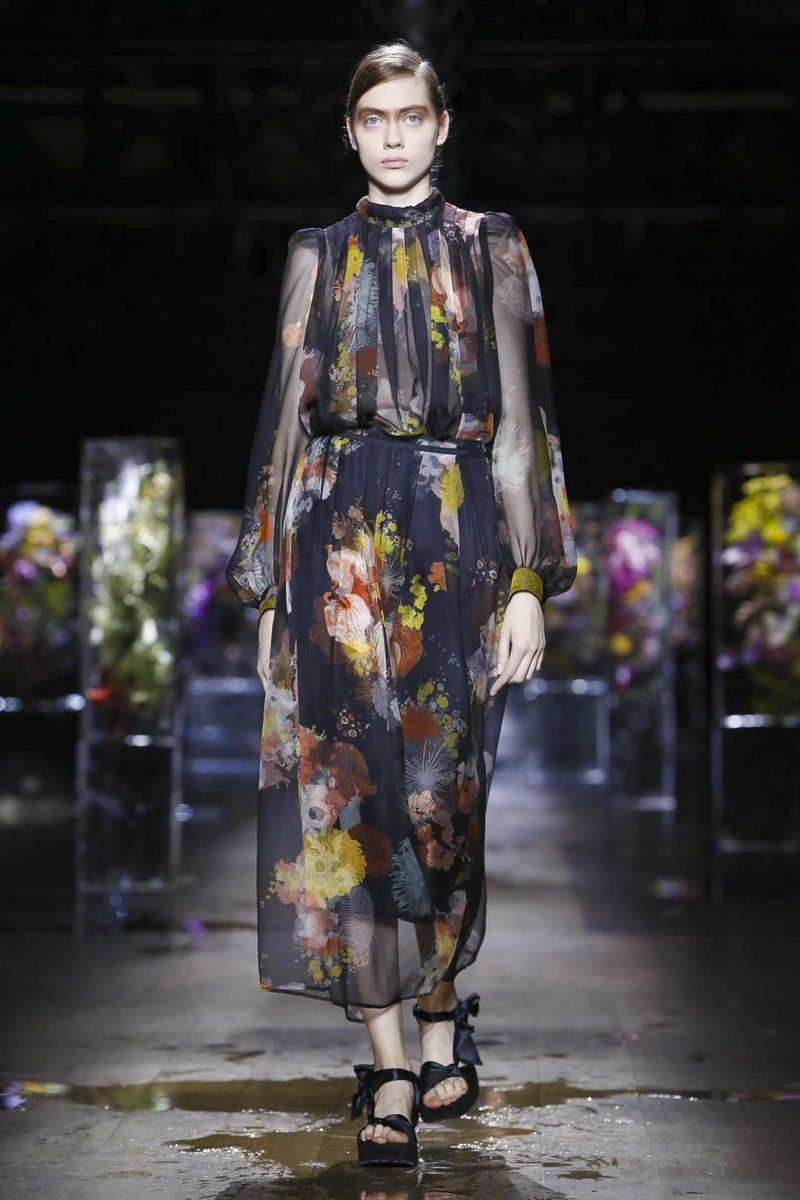 Slowly slowly, water flooded the Dries Van Noten catwalk. Melting blocks of  ice, parallelpiped with big bouquets of flowers magically trapped inside,  ...