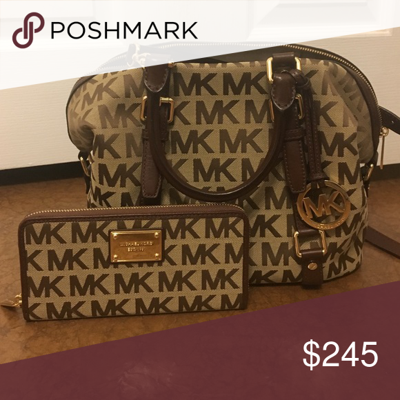Michael Kors Set Michael Kors Crossbody/handbag and wallet set. Both have NEVER been used. If you want more pictures go to the individual ones on my page. Both are in perfect condition. Michael Kors Bags Crossbody Bags