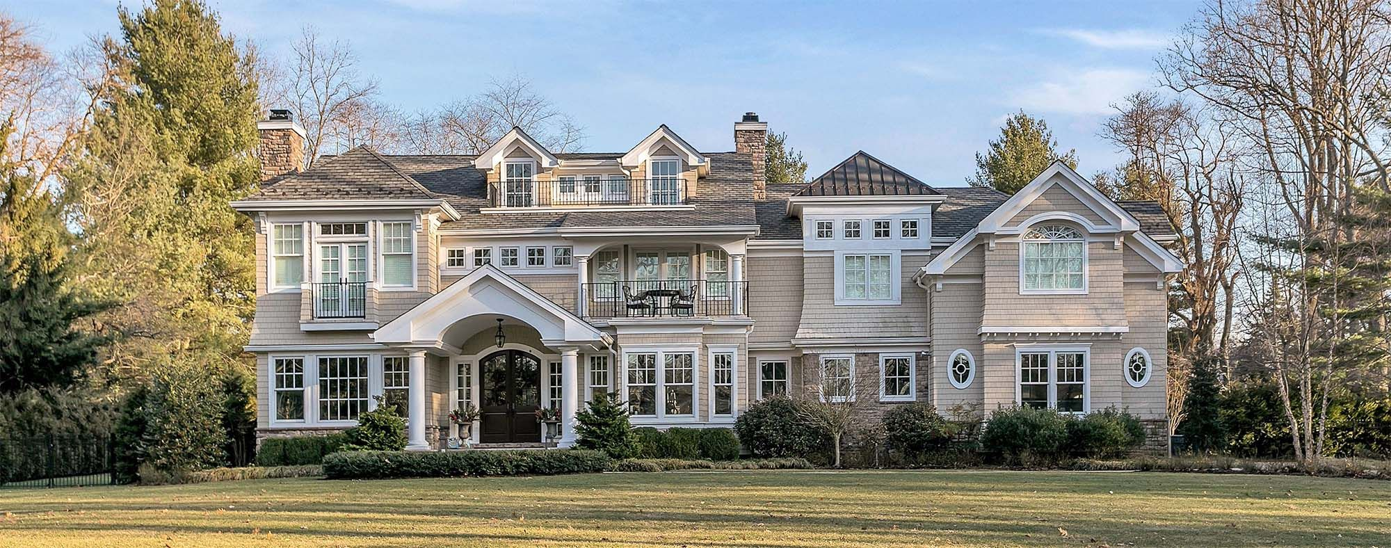 Large Custom Home With Tan Cedar Shake Siding And White Trim Stone Houses Shingling New Home Builders