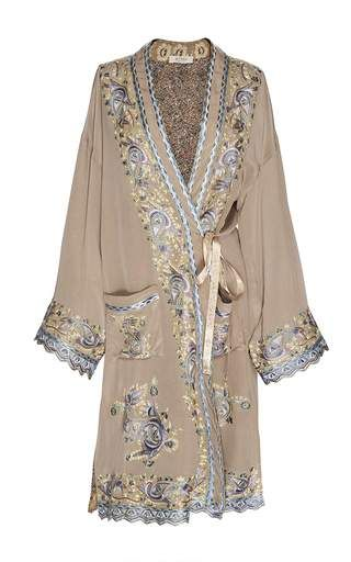 This reversible silk trench from **Etro** features ornate threadwork embroidery at the placket and cuffs, printed potpourri floral on the reverse, and embroidered patch pockets.
