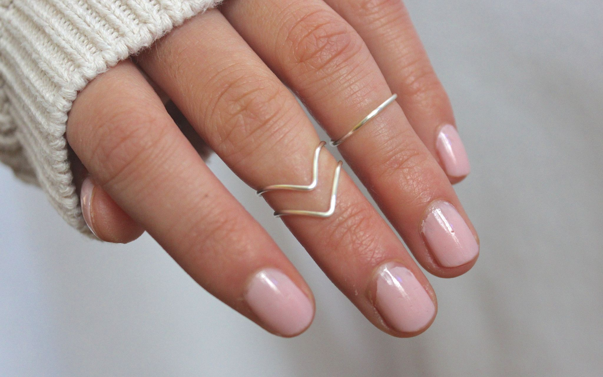 A set of three knuckle rings! (2 chevron style and 1 band style) These are silver knuckle rings made out of non-tarnish silver plated wire. They are adjustable. Your knuckle ring size is typically 3 s