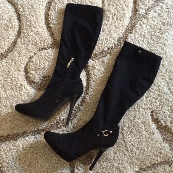 """Brand new GUESS boots size 7 Brand new without box never worn guess boots size 7. Very flattering on legs! Has size zip for easy wear! Heel height 5"""" long Guess Shoes Heeled Boots"""