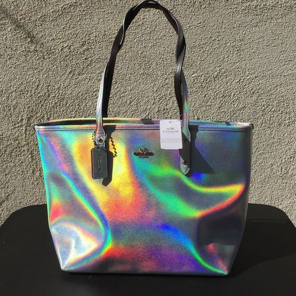 Coach Silver Hologram Zip Top Tote (C) Brand new w/tags 100% authentic. Bag is at this price because of the wear corner & the mark on it. Mark is on back side of the handbag. Price is firm.  Coach Bags Totes