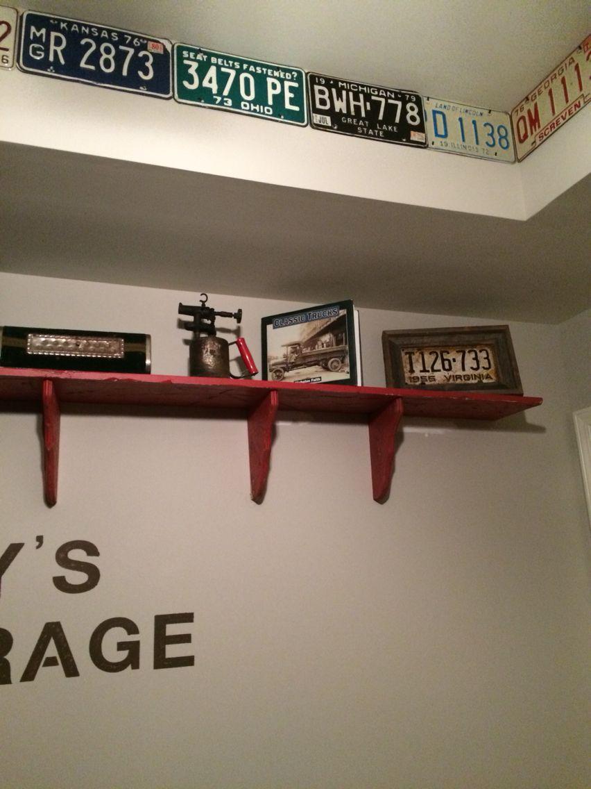 Shelf with vintage auto decor. Notice the vintage license plate ...