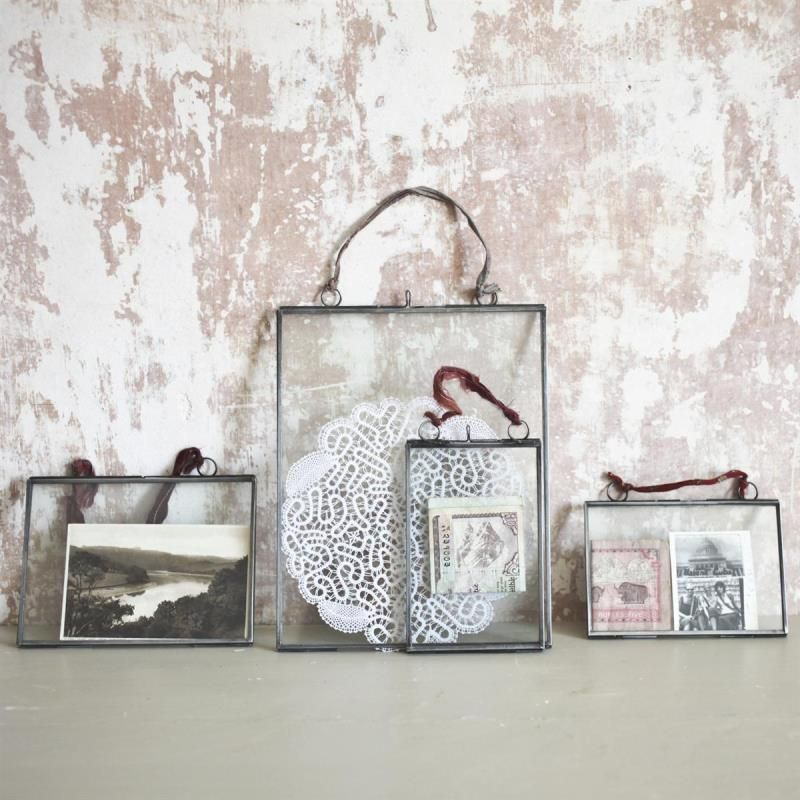 Hinged glass frame filled with old photos, letters, and doilies ...