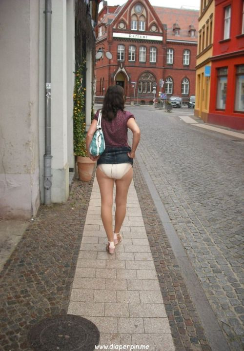 Girl peeing with dress in public