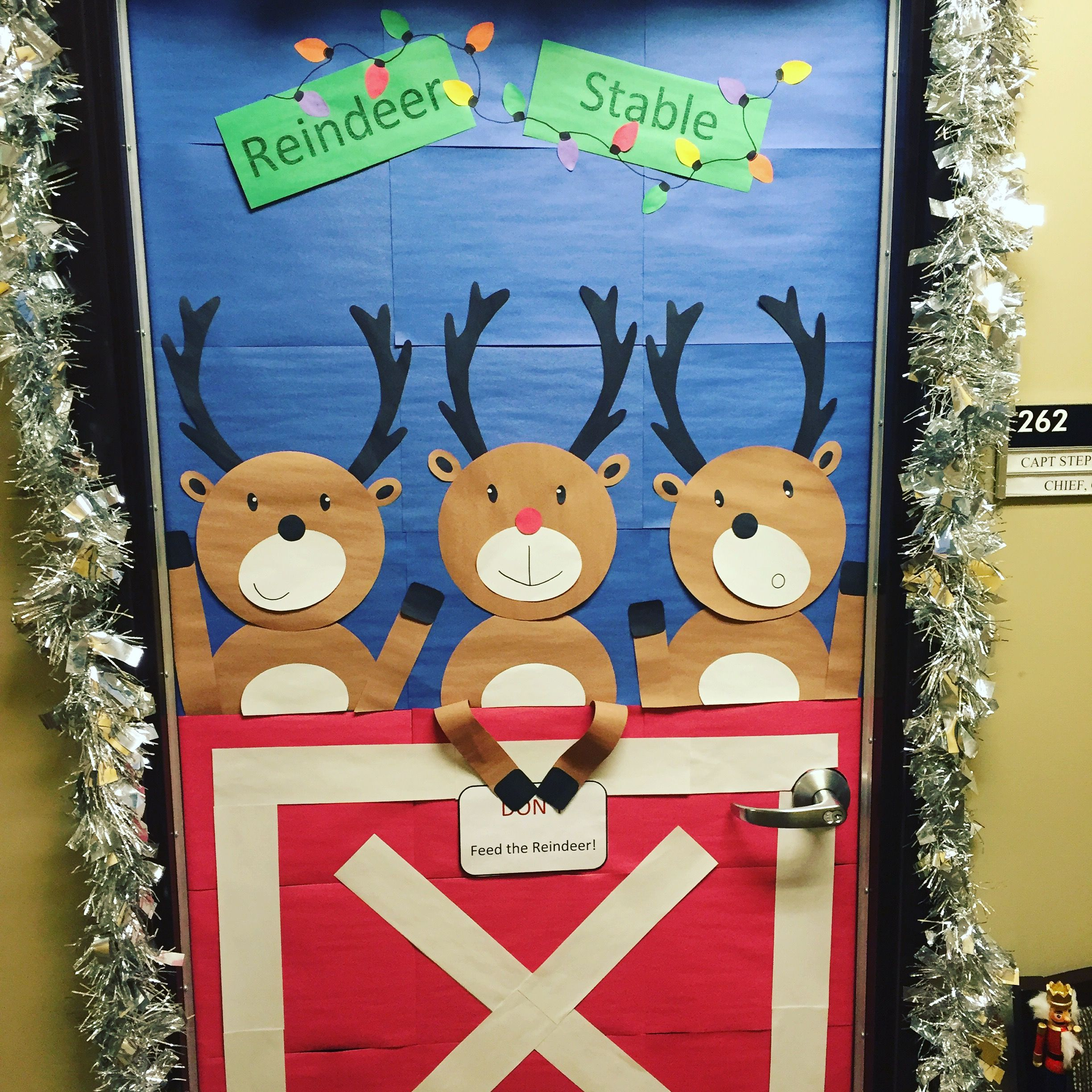 Reindeer Christmas door decoration with Rudolph at the