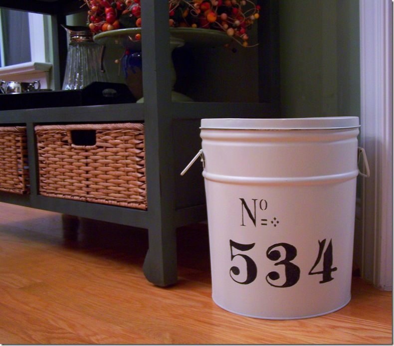 Take an old popcorn or tin can and paint to match your home decor!  Good idea and cheap.