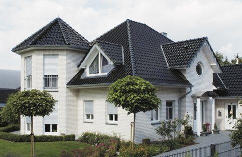 Best Wienerberger Dream House Shines Under Black Roof Tiles 400 x 300