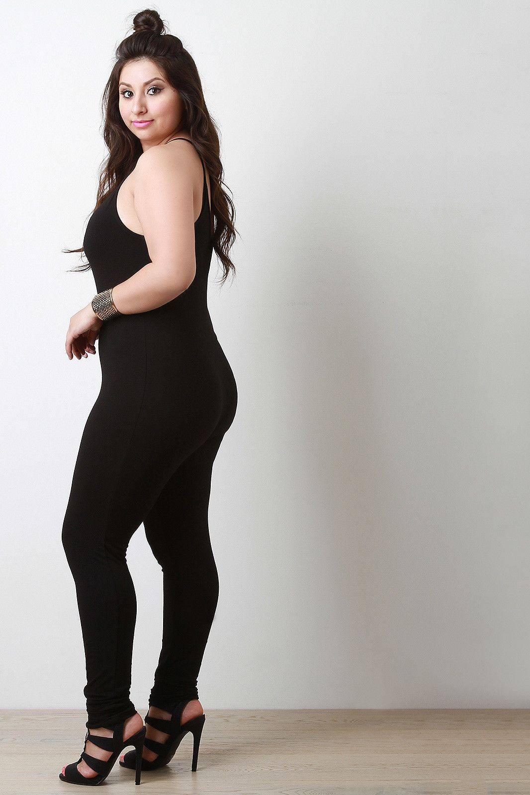 9e1774c03c61 This plus size jumpsuit features soft jersey knit, spaghetti straps, scoop  neckline, low cut back, and taper cut legs. Fitted design.