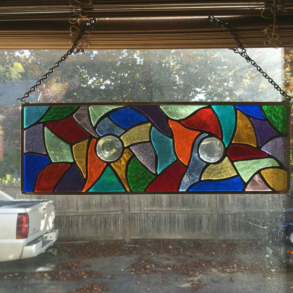 Multi colored stained glass window hanging
