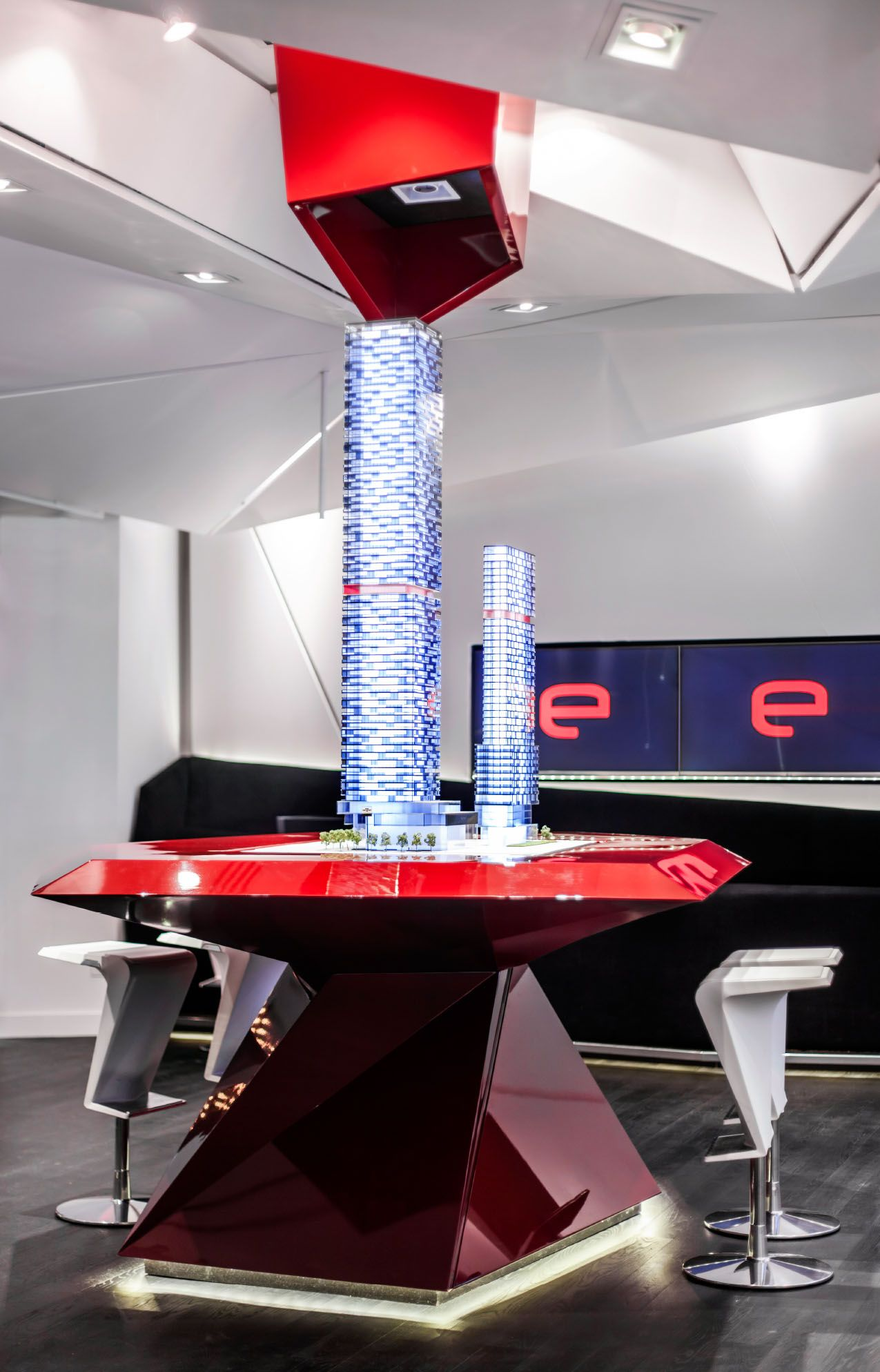 E-Condos | Showcase Table // Eventscape engineered, fabricated and installed all elements of the multiple features // Commercial Illuminated Innovative