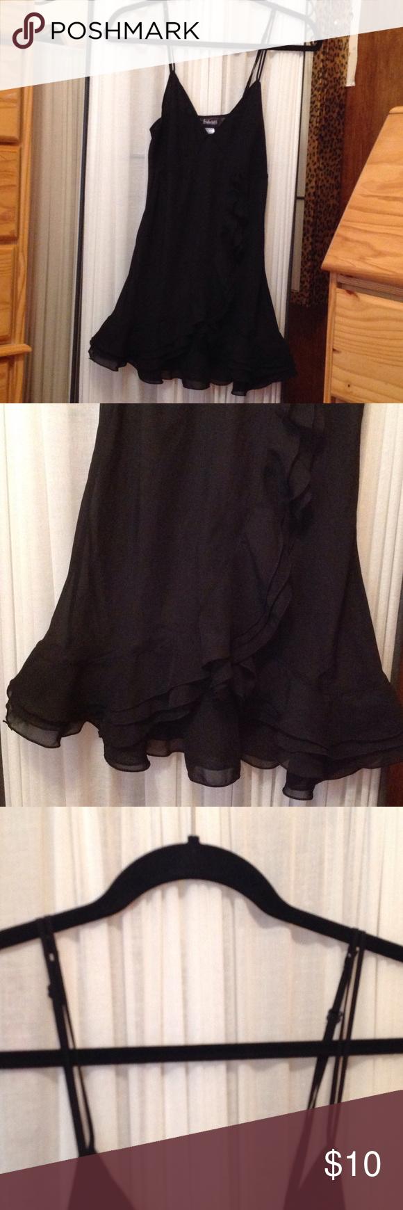 Black double strapped ruffle baby doll. Black double strapped ruffled baby doll.  The straps are adjustable. I got it from Fredericks size medium. Intimates & Sleepwear Chemises & Slips