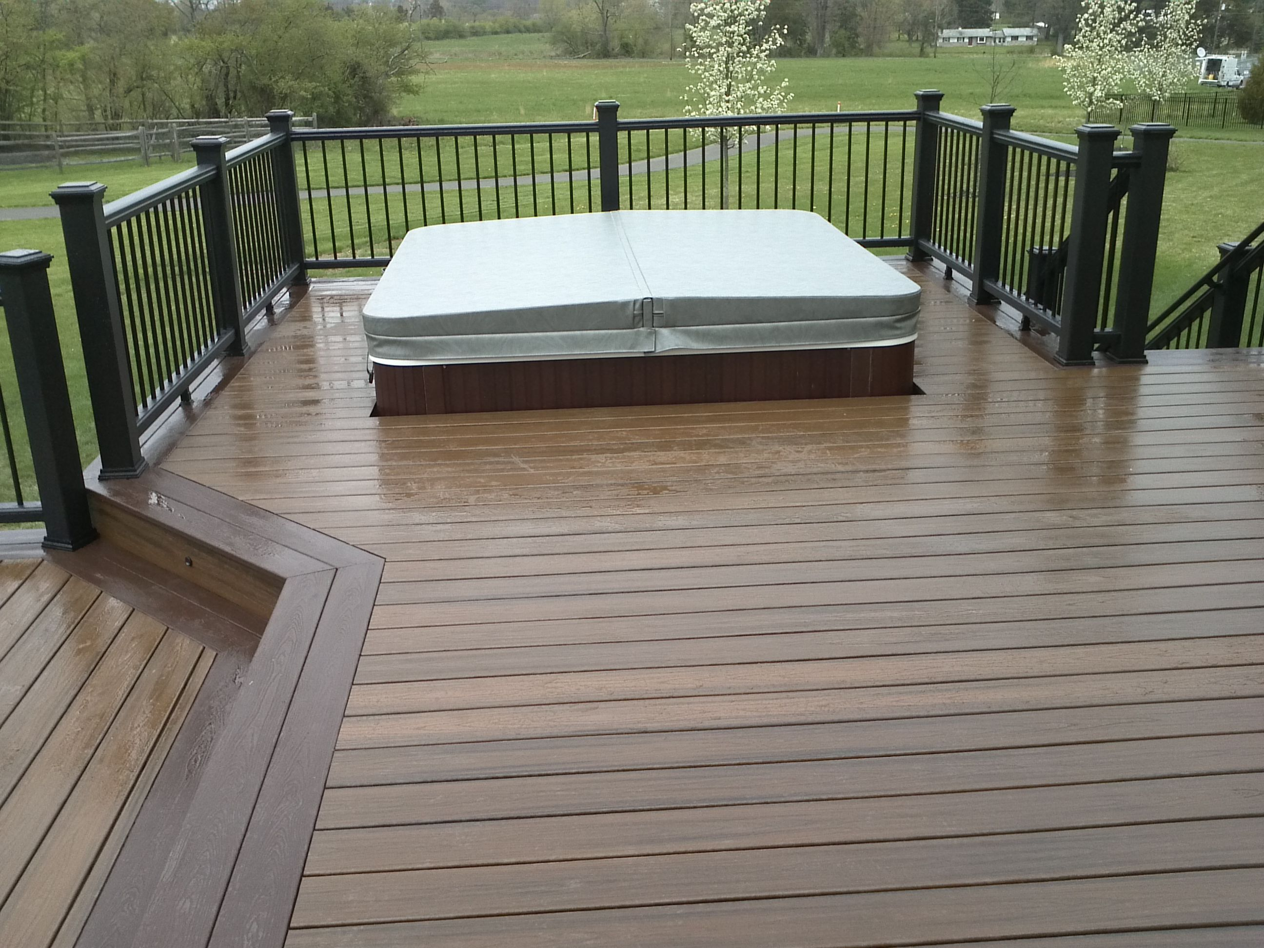 belleville lower very walk wrought railings with one hot is decks owner custom has a overlooking carpentry the tub e here balcony near completed iron t happy p deck
