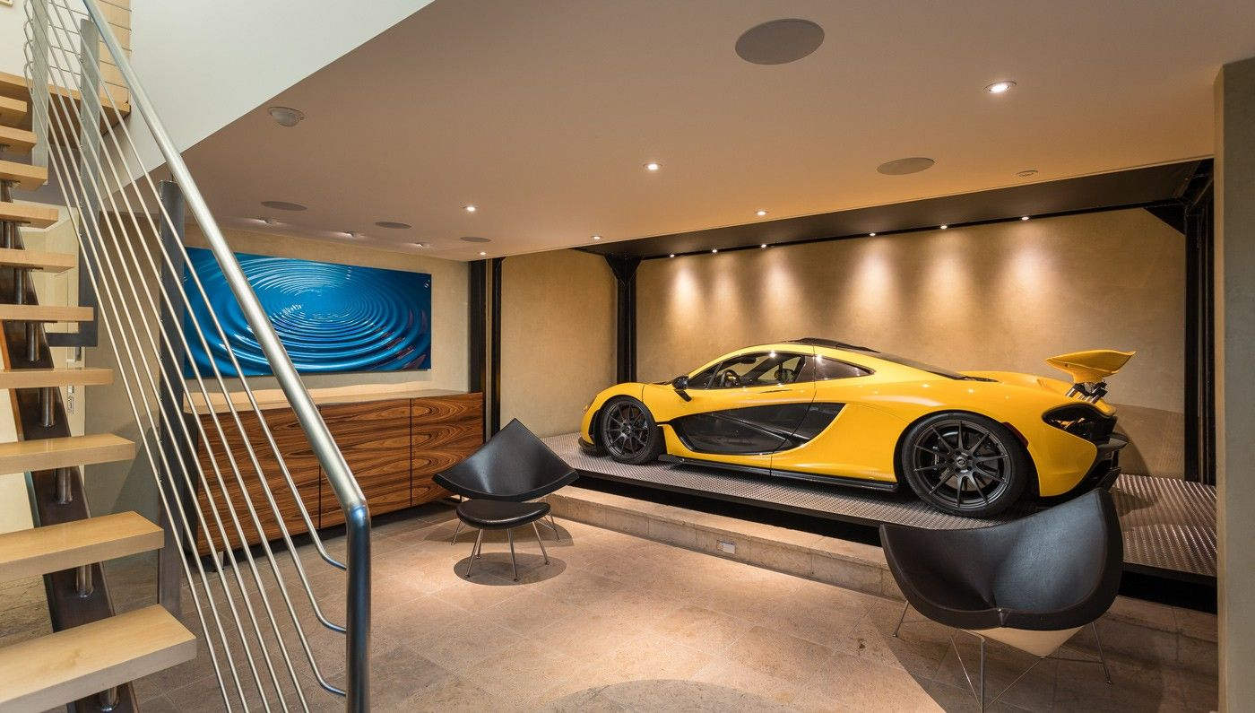 Car Lift To Basement Garage A Stunning Subterranean Garage Anchors The Modern Glass Walled