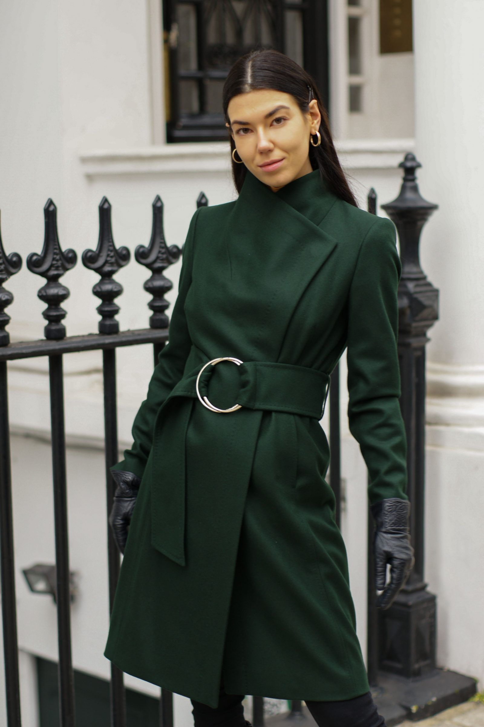 aee6e61af Brunette fashion blogger wearing green belted wool coated from Ted Baker