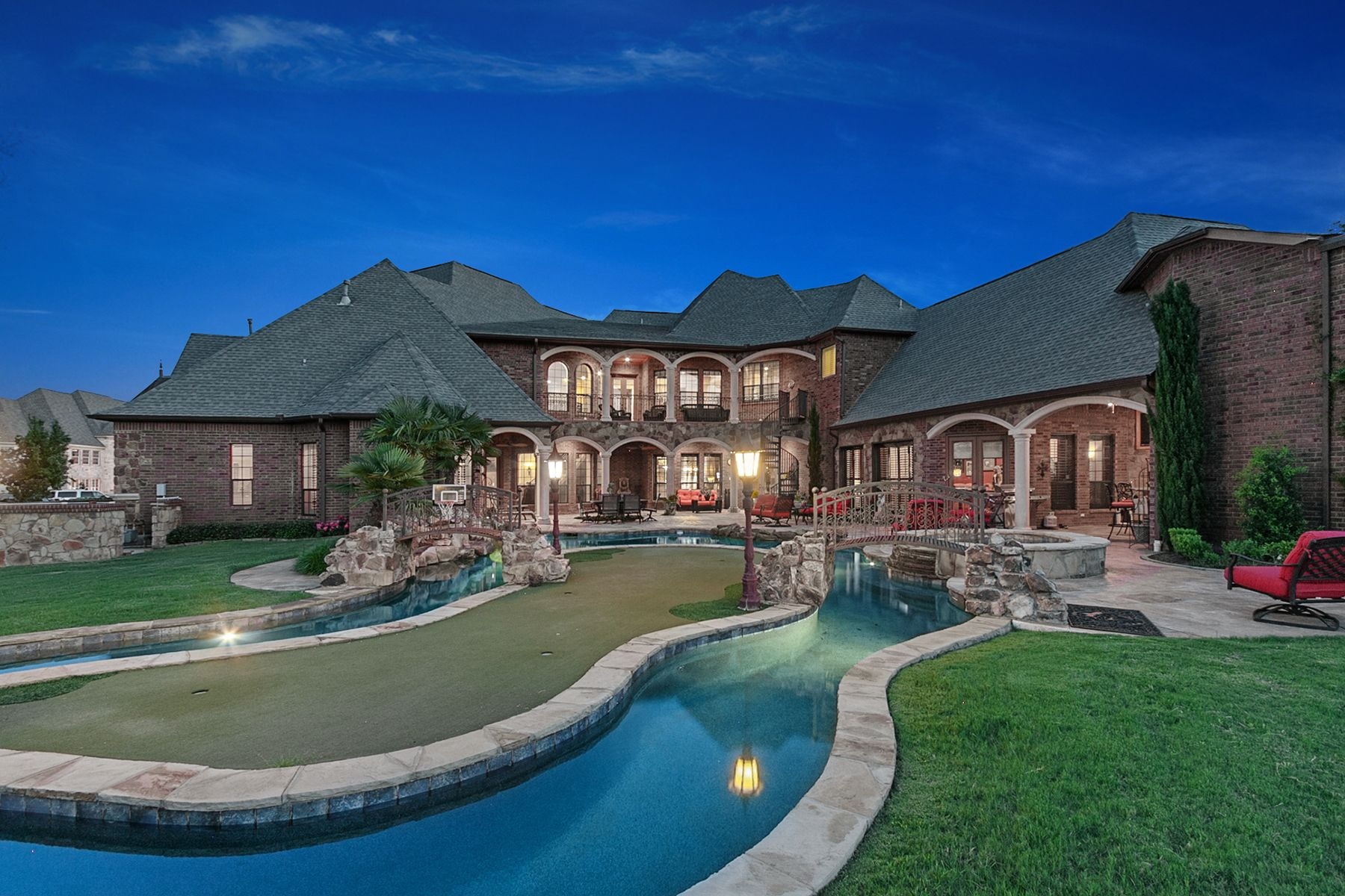Lazy River Pool Design With Putting Green, An Island, Two  Bridges...unforgettable Backyard On This #Southlake Estate!