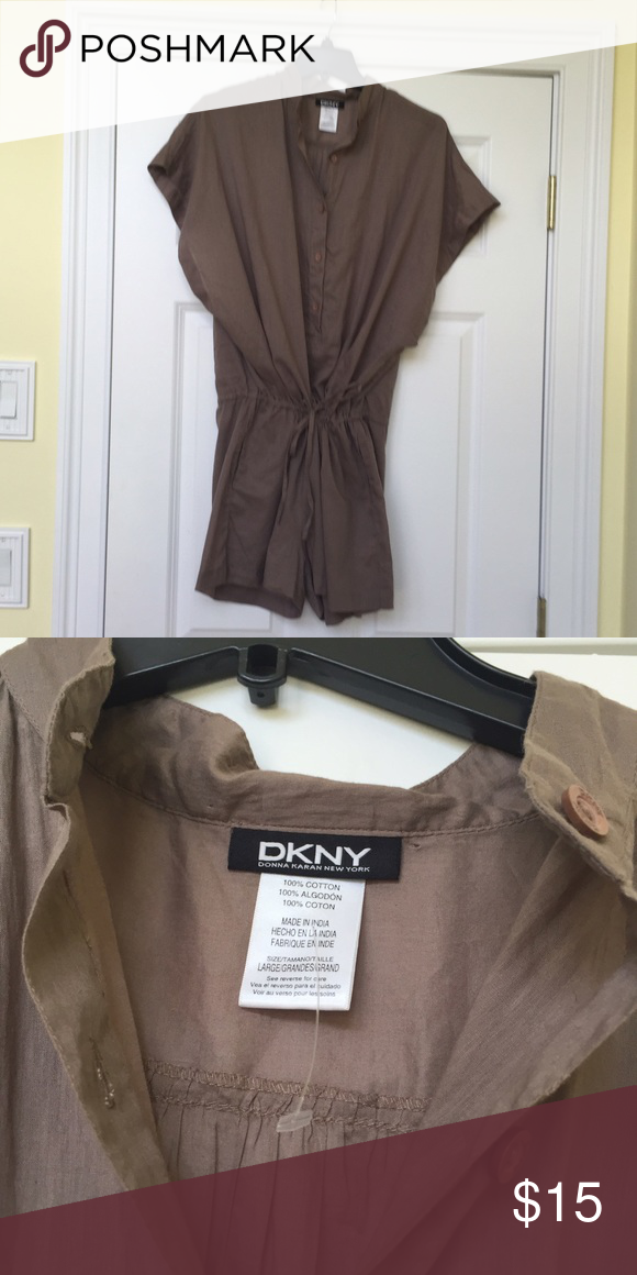 DKNY Romper  NEVER WORN This DKYN romper is 100% cotton and is very light. It features two pockets in the front and a drawstring waist. This romper has 5 buttons from the waist to the neckline and the arms/ sleeves are cut wider. It has NEVER been worn. It is in perfect condition. Smoke Free Home. DKNY Other