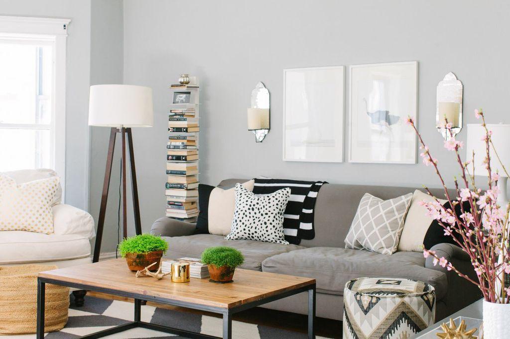 Kaczmarski Chicago Apartment Tour Living Room Grey White Black Barn Couch USA Chevron Rug Sharon Montrose Prints Lily Studio Throw
