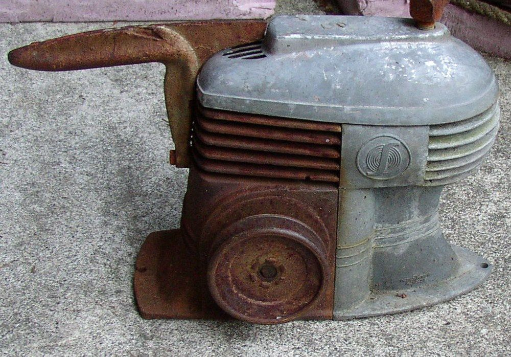 Vintage gas pump yard art. Recycled air compressor tanks