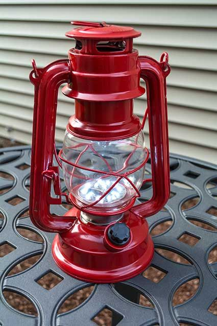 hurricane lantern light 9 5 inch red metal battery op dimmable