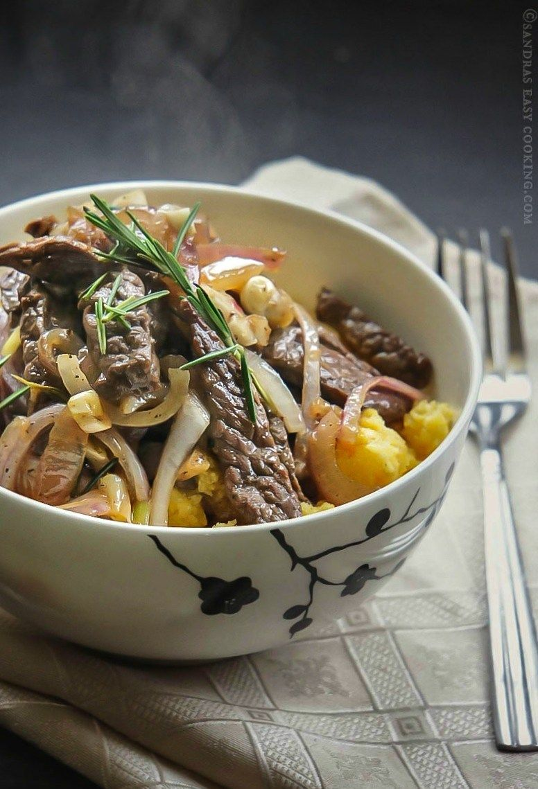 Sautéed Beef with Onions over Creamy Polenta images