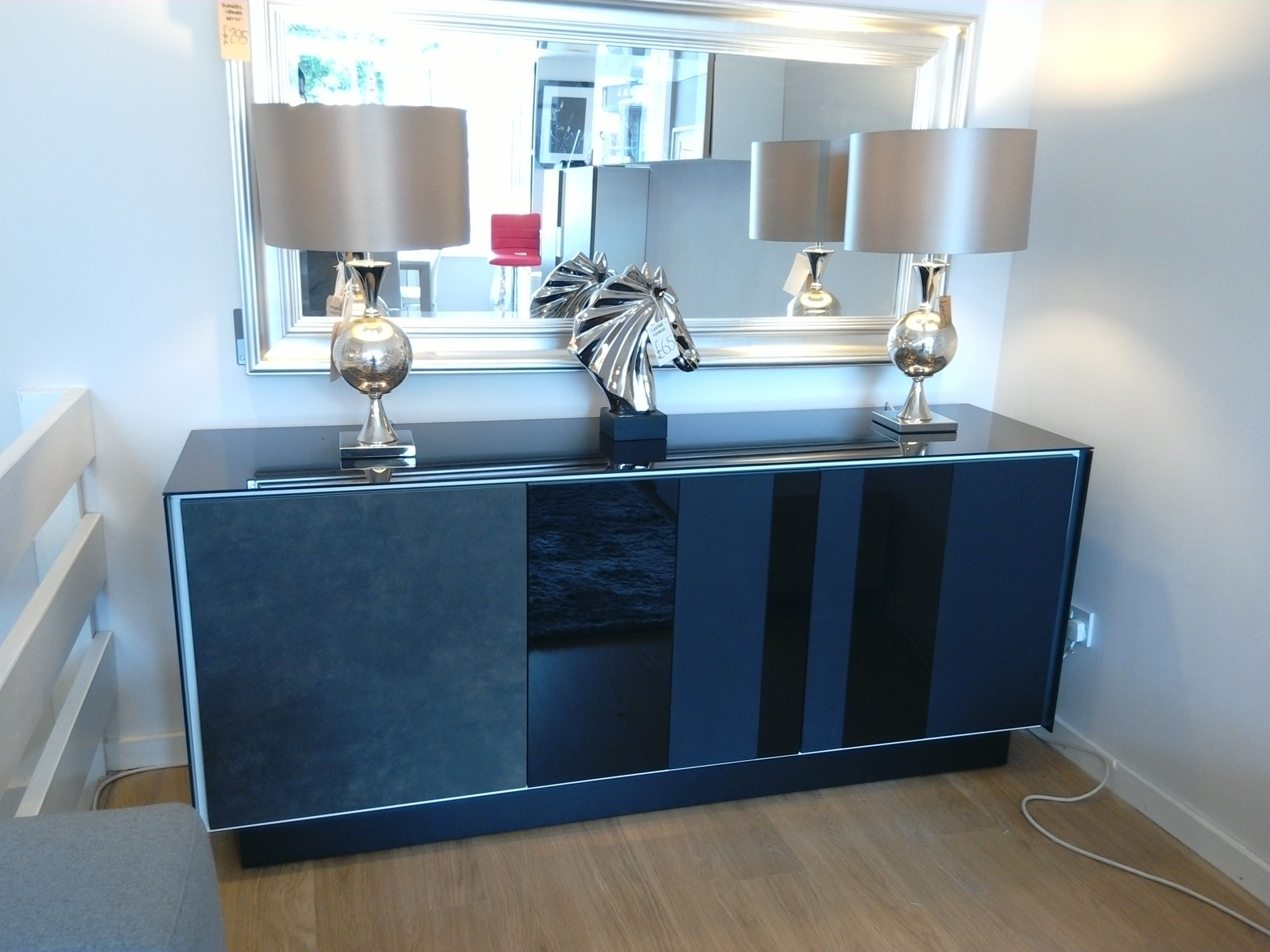 Sideboard from our Book range in black glass. Door fronts in ceramic and black glass lines alternating matt and gloss. Internal frame detail in white. Endless possibilities. Shown as displayed at our Surbiton showroom.