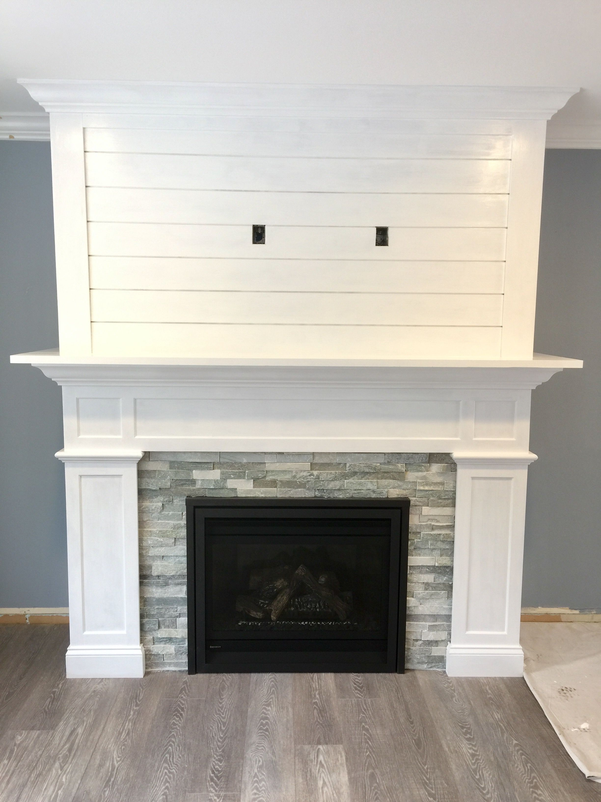 Our craftsman style fireplace with shiplap mantel fireplace